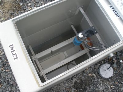 A custom flume and sampling chamber manufactured by BMS for flow monitoring with an ultrasonic flow meter