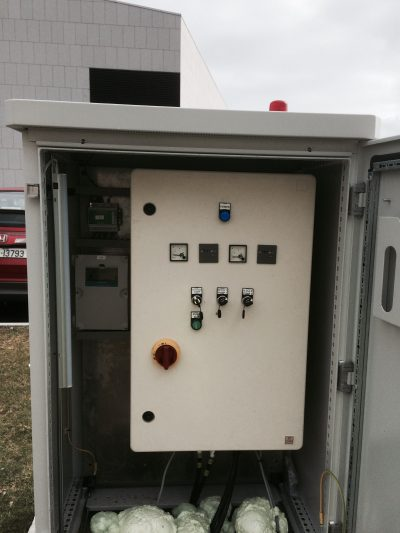 Pump Control Panel installed in kiosk with flashing beacon