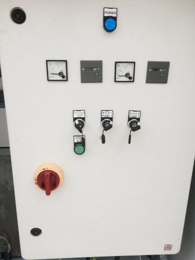 Pump Control Panel with off/hand/auto switches, hour counters, ammeters and lock out