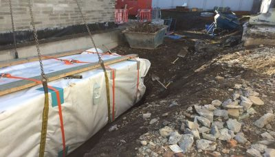 Fully off site assembled Stormbreaker attenuation system being lowered into excavation